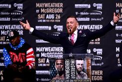 "Conor McGregor Really Wore A Custom ""F*ck You"" Suit At Press Conference"