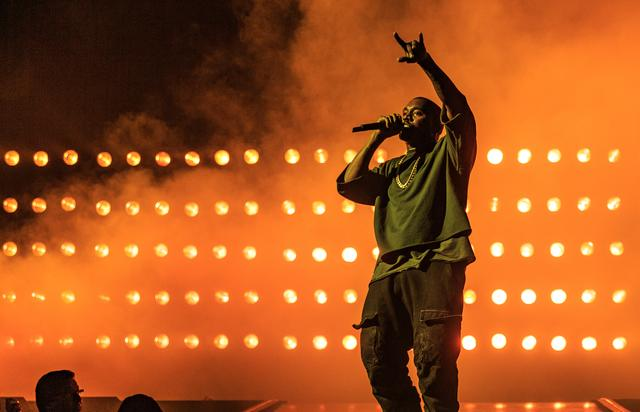 Kanye West performing at iHeart Radio fest