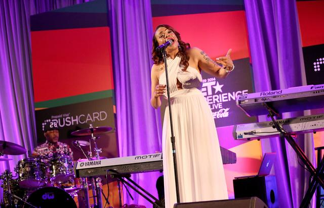Singer/ songwriter Faith Evans performs onstage at the Acoustically Speaking event during the 2014 BET Experience At L.A. LIVE on June 28, 2014 in Los Angeles, California.