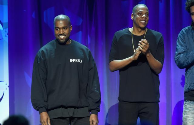Kanye West (L) and JAY Z onstage at the Tidal launch event #TIDALforALL at Skylight at Moynihan Station on March 30, 2015 in New York City. (Photo by Jamie McCarthy/Getty Images for Roc Nation)