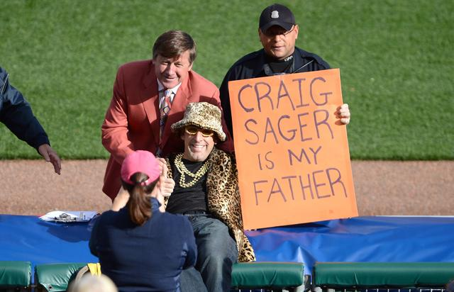A fan poses with TBS analyst Craig Sager as the Detroit Tigers host the New York Yankees during game four of the American League Championship Series at Comerica Park on October 18, 2012 in Detroit, Michigan.