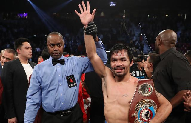 Manny Pacquiao of the Philippines poses after his unanimous-decision victory over Jessie Vargas at the Thomas & Mack Center on November 5, 2016 in Las Vegas, Nevada. Pacquiao won the WBO welterweight championship
