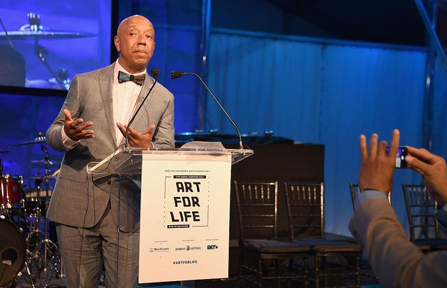 CEO of Rush Communications Russell Simmons speaks onstage during Rush Philanthropic Arts Foundation's 2016 ART FOR LIFE Benefit at Fairview Farms on July 16, 2016 in Bridgehampton, New York.