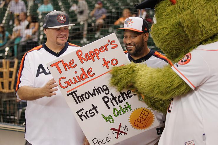 Houston rappers Fat Joe, left, and Bun B receive instructions from Houston Astros mascot Orbit before throwing out first pitch at Minute Maid Park on September 16, 2014 in Houston, Texas.